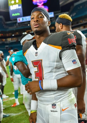 Tampa Bay Buccaneers quarterback Jameis Winston (3) looks on after defeating the Miami Dolphins at Hard Rock Stadium.