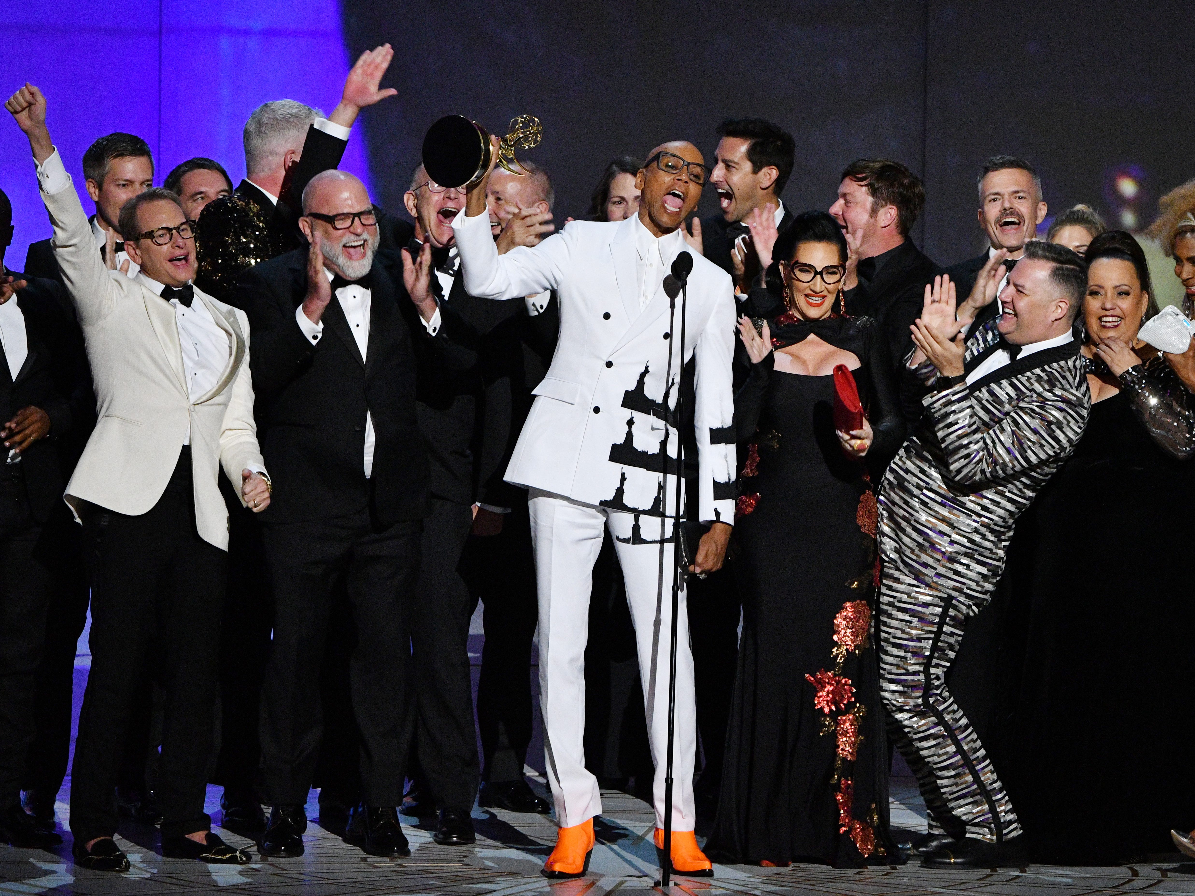 """RuPaul Charles and the cast and crew of """"RuPaul's Drag Race"""" on VH1 accept the award for outstanding reality-competition program."""