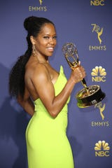 Regina King poses with her Emmy for Lead Actress in a Limited Series or a Television Movie.