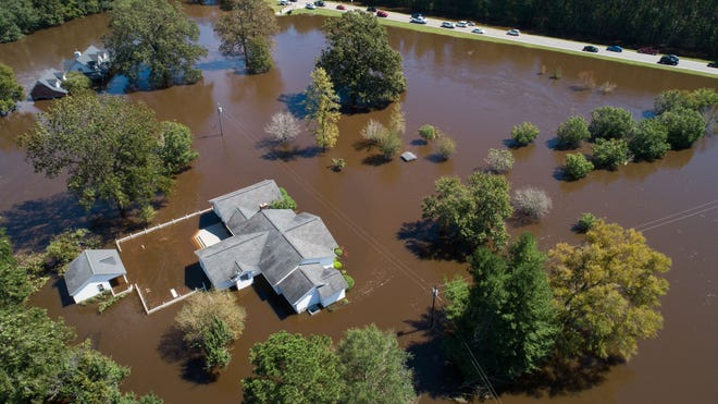 Sept. 18, 2018; Linden, NC, USA; Homes on the Wood family's property are seen severely flooded Tuesday, Sept. 18, 2018, in the aftermath of Florence in Linden, N.C. Dale Wood, who has lived on the property about 47 years, and his wife, Angie Wood, said their home was also flooded by the nearby Little River after Matthew, but not nearly to the same levels.