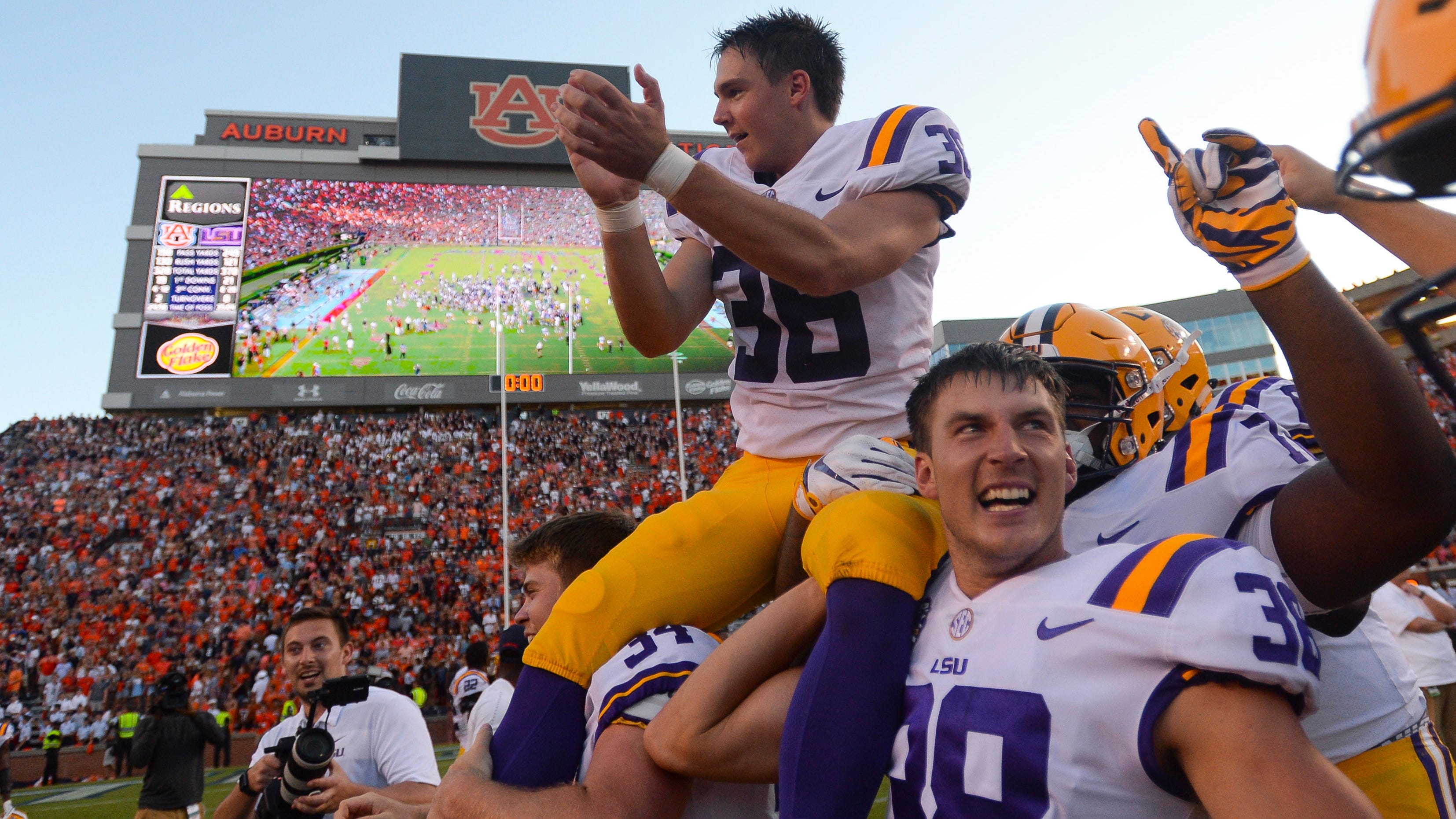Cole Tracy celebrates after kicking the game-winning field goal to defeat the Auburn.