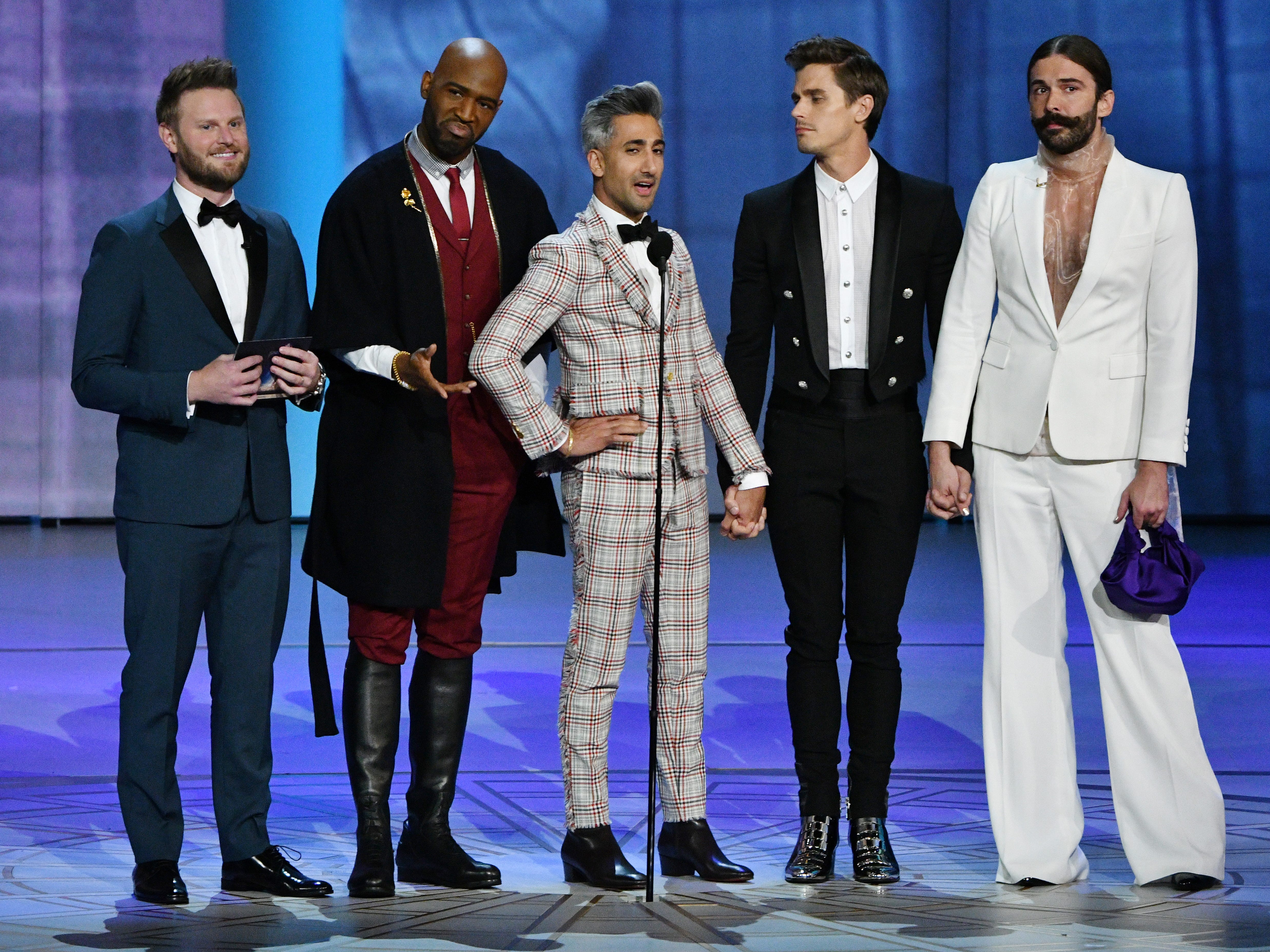 """The cast of """"Queer Eye"""" presents the award for lead actor in a drama series."""