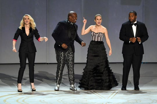 "Kate McKinnon (from left), Tituss Burgess, Kristen Bell and Kenan Thompson perform the diversity-themed opening number ""We Solved It"" at the 70th Emmy Awards."