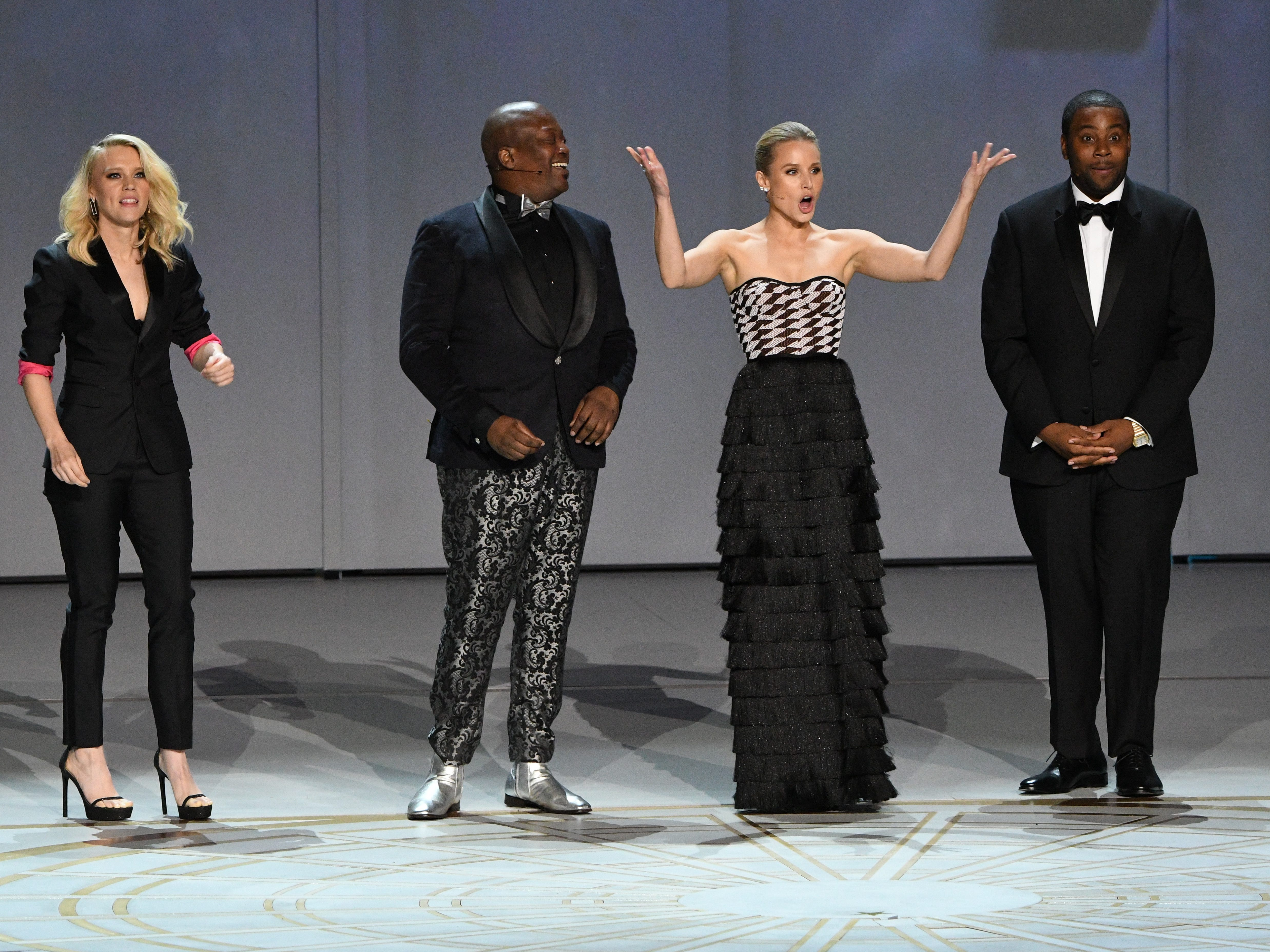 """Kate McKinnon, Tituss Burgess, Kristen Bell,and Kenan Thompson perform """"We Solved It"""" during the show opening."""