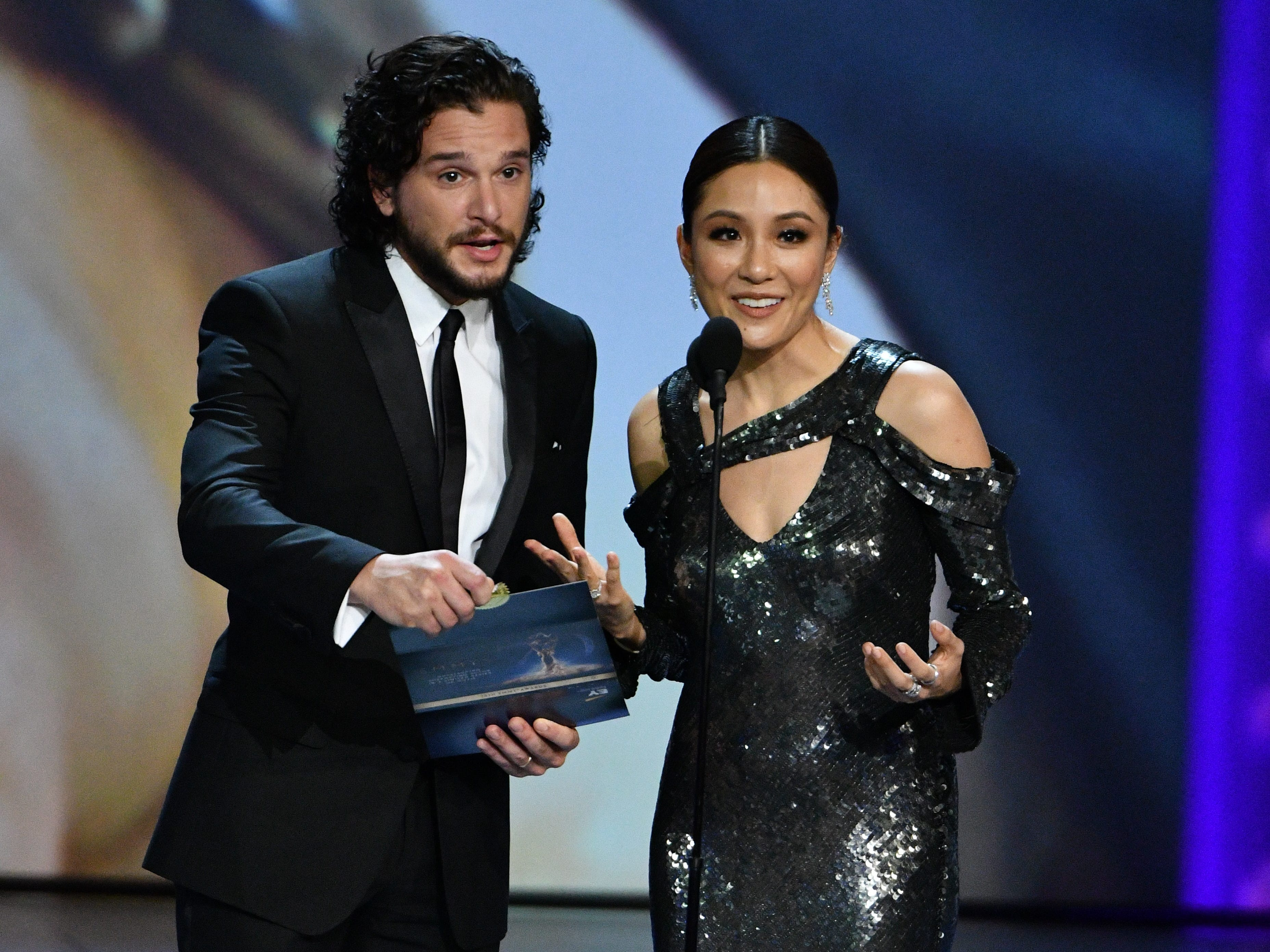 Kit Harington, left, & Constance Wu present the award for supporting actor in a limited series or movie.