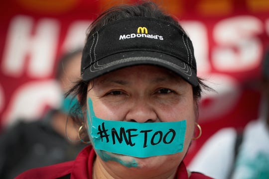 McDonald's workers are joined by other activists as they march toward the company's headquarters to protest sexual harassment at the fast food chain's restaurants on Sept. 18, 2018 in Chicago.