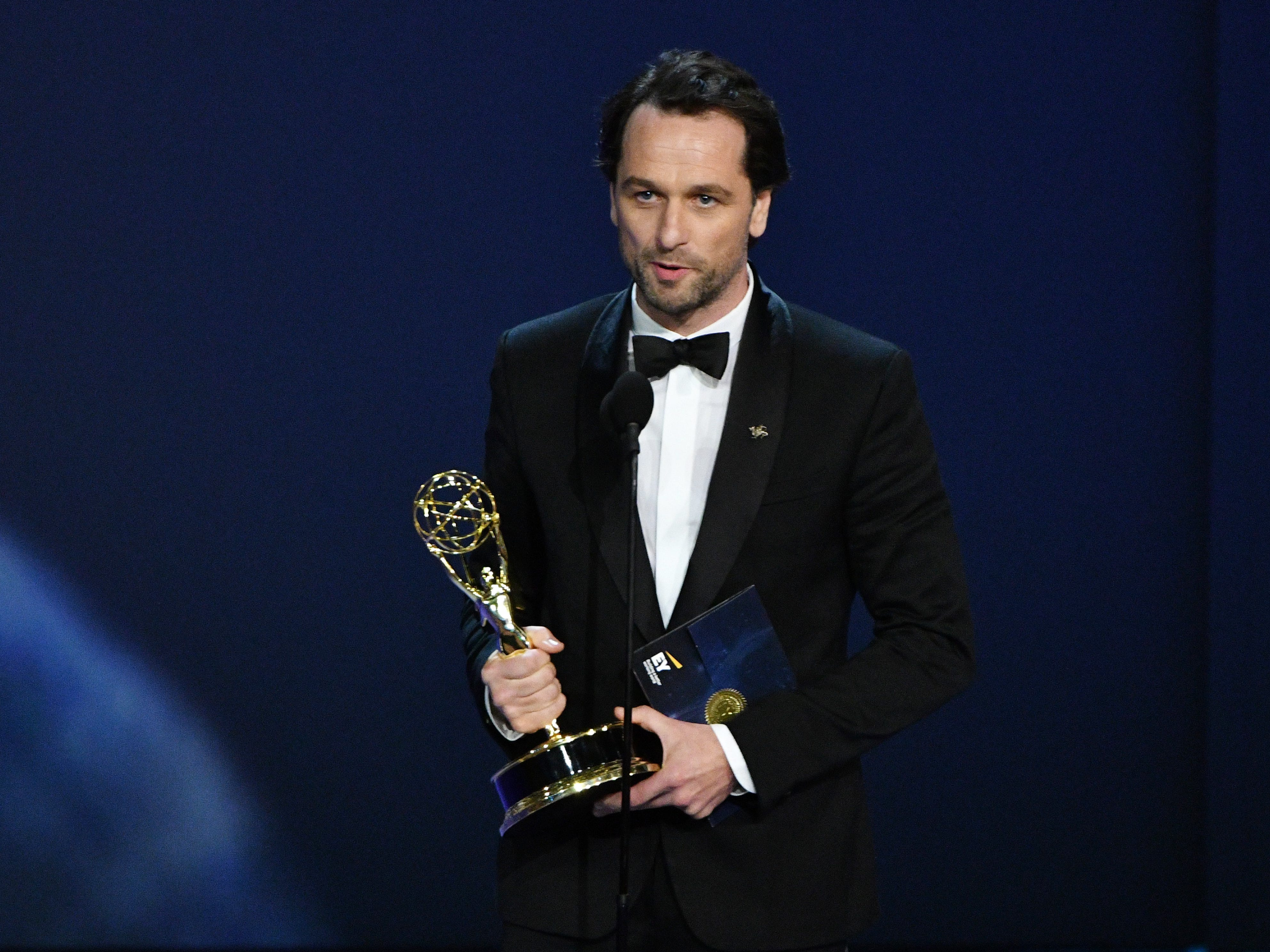 """Matthew Rhys accepts the award for lead actor in a drama series for his role in """"The Americans"""" on FX Networks."""