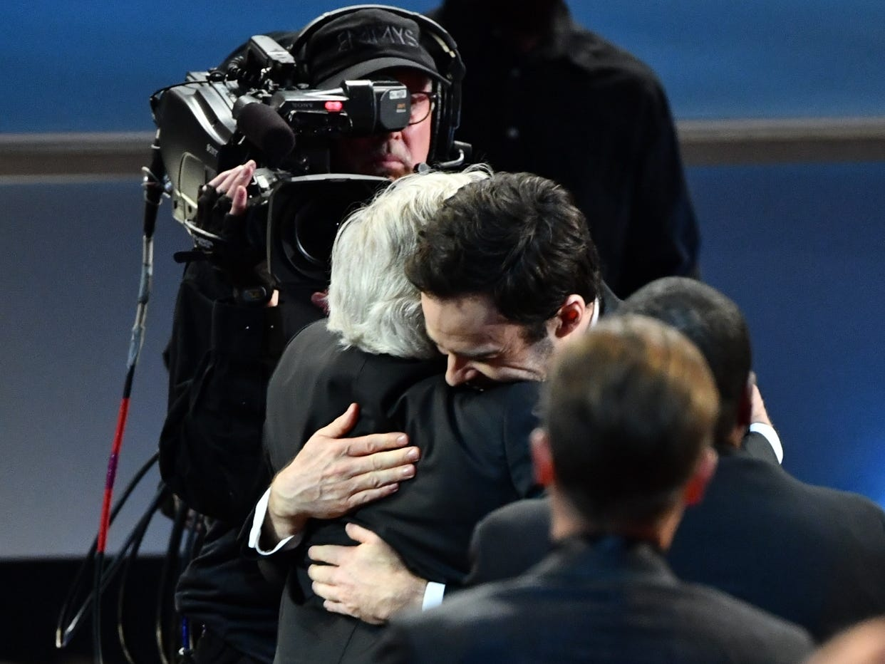 Henry Winkler, left, gets a hug from Bill Hader as he makes his way to the stage to accept the award for supporting actor in a comedy series.
