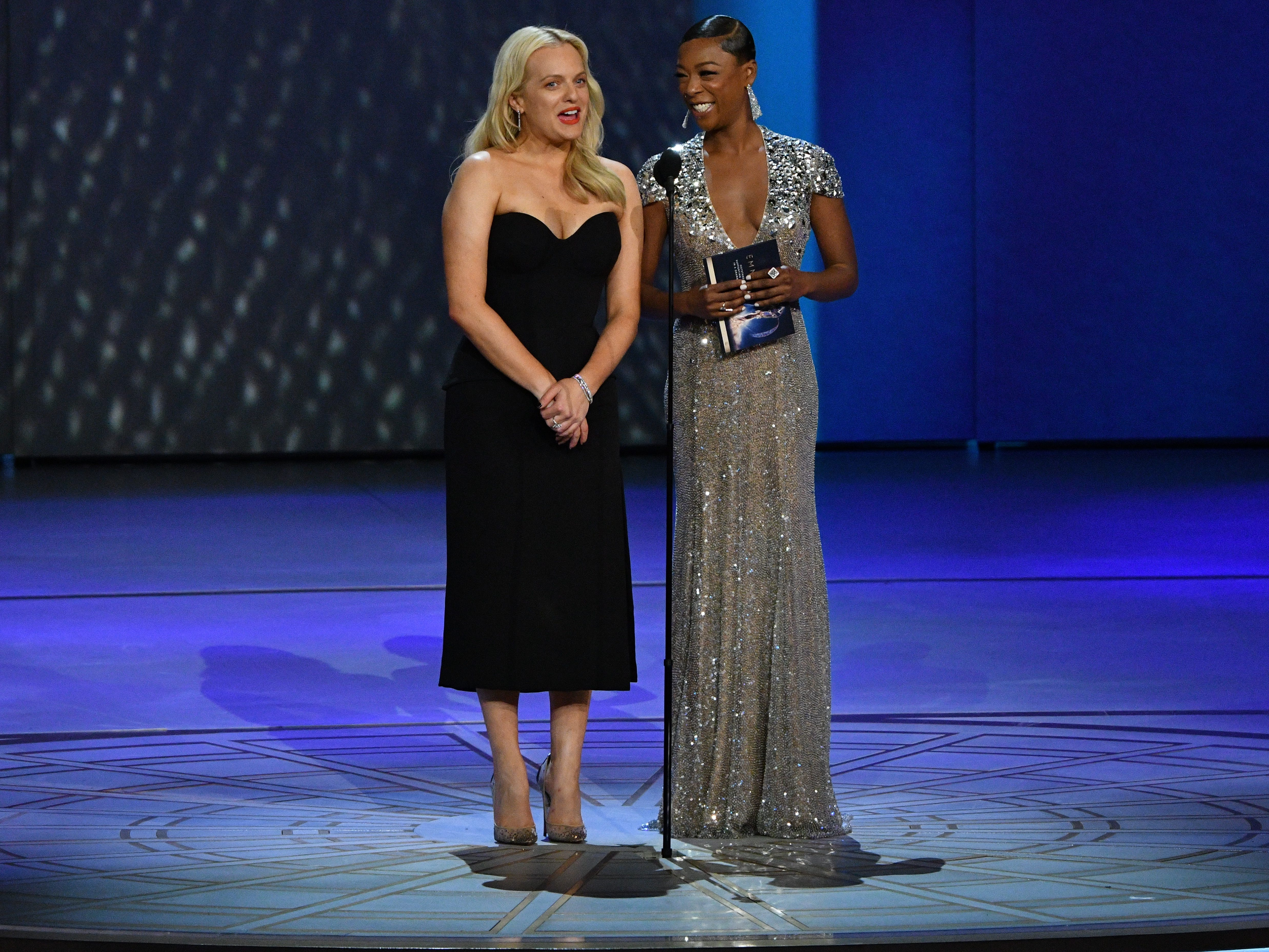 Elisabeth Moss, left, and Samara Wiley present the award for supporting actress in a drama series.