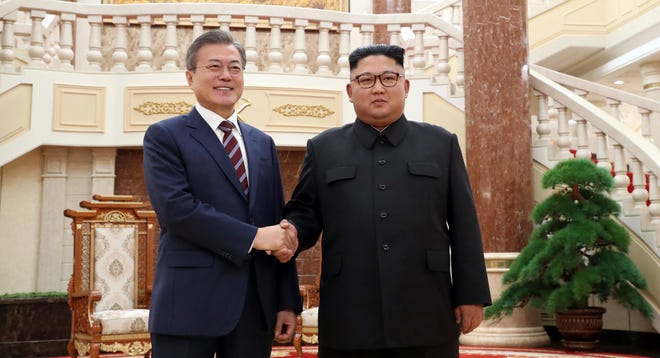 North Korean leader Kim Jong Un, right, shakes hands with South Korean President Moon Jae-in before their summit at the headquarters of the Central Committee of the Workers' Party in Pyongyang, North Korea, Tuesday, Sept. 18, 2018.