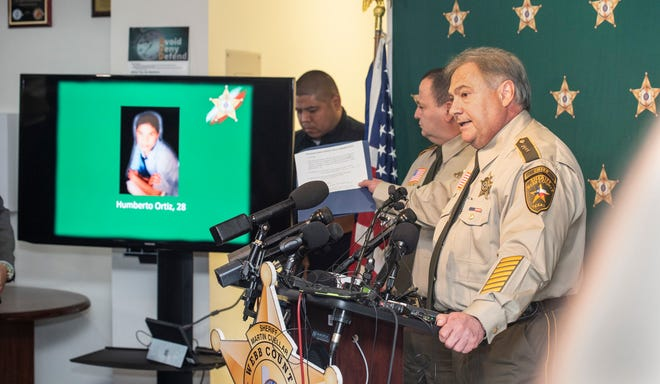 Webb County Sheriff's Department Assistant Chief Federico Garza displays the images of Juan David Ortiz's victims on Monday, Sept. 17, 2018, during a press conference at the Webb County Sheriff's Office.