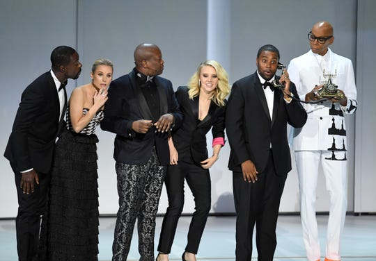 (L-R) Sterling K. Brown, Kristen Bell, Tituss Burgess, Kate McKinnon, Kenan Thompson, and RuPaul perform onstage during the 70th Emmy Awards.