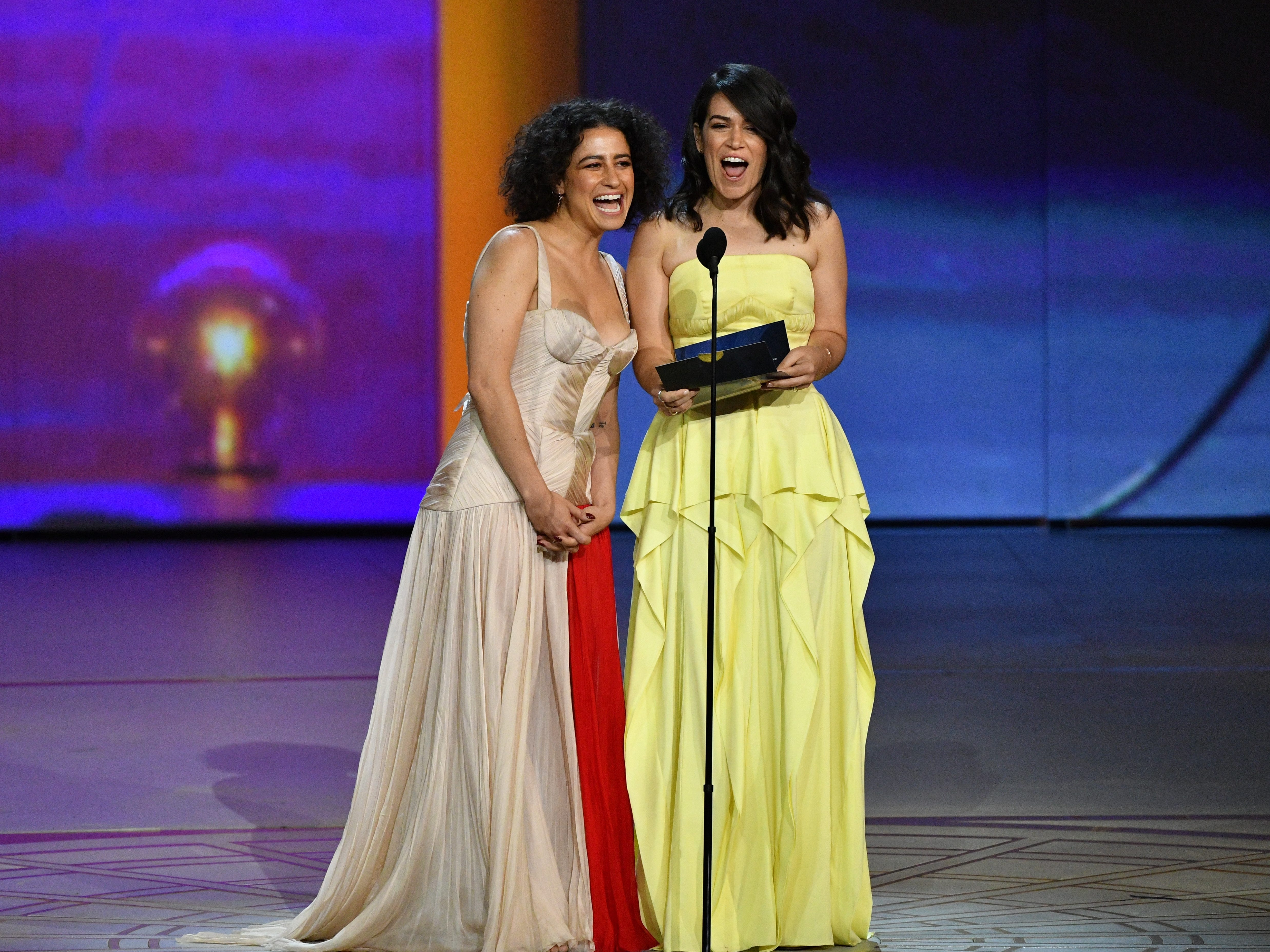 Ilana Glazer, left, and Abbi Jacobson present the award for outstanding Writing for a Variety Special.