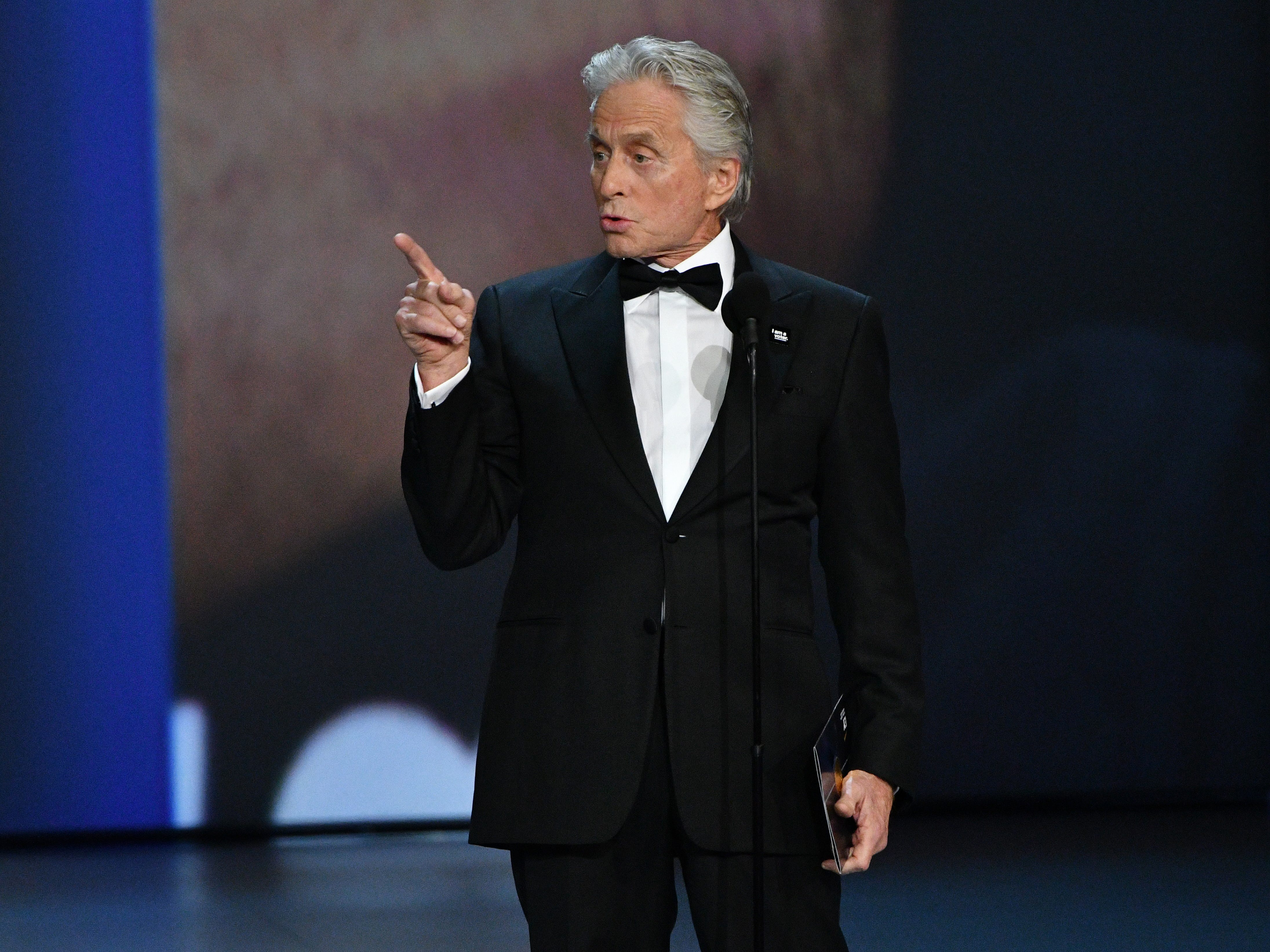 Michael Douglas presents the award for lead actor in a comedy series.