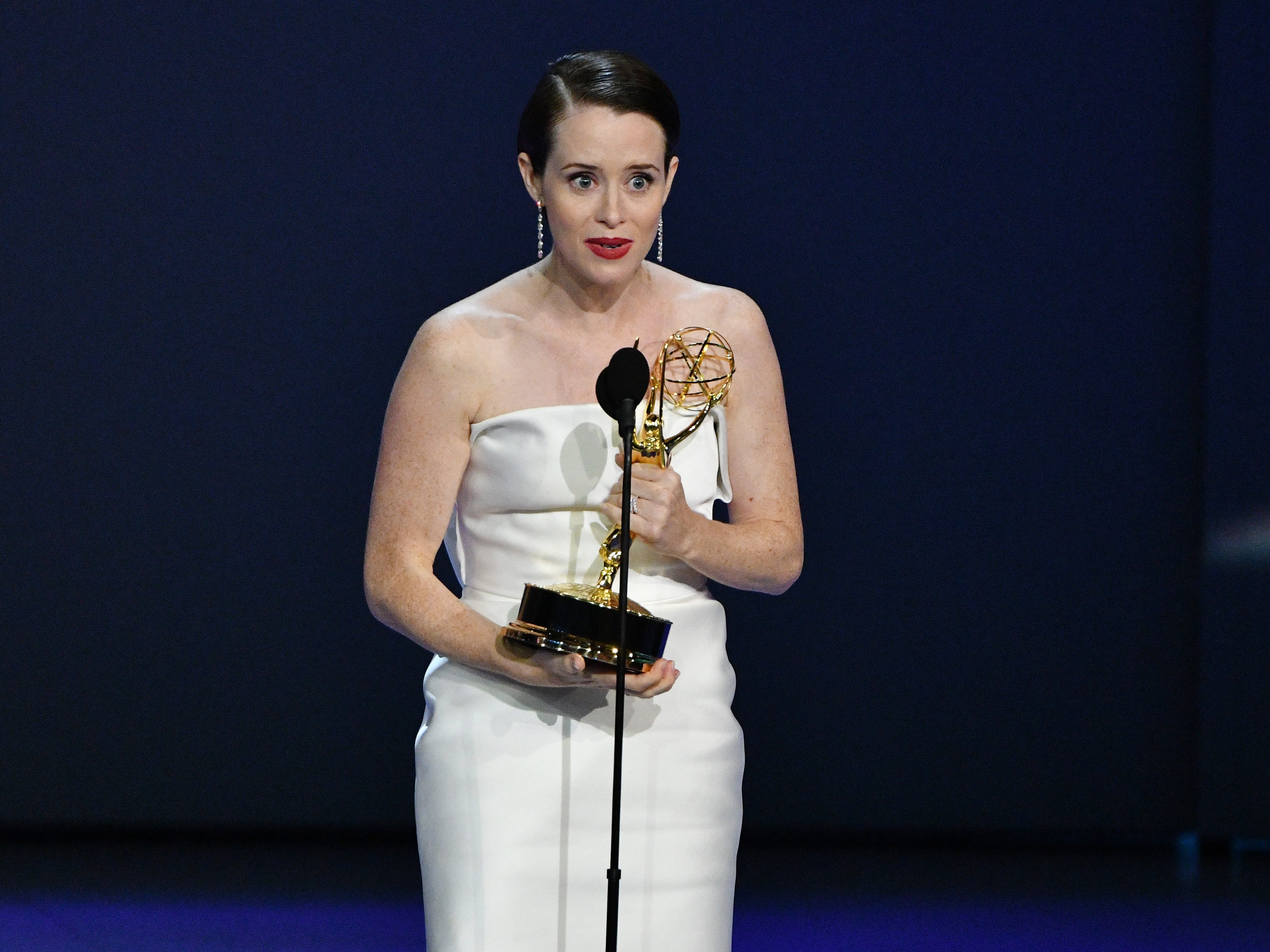 """Claire Foy accepts the award for lead actress in a drama series for her role in """"The Crownî"""" on Netflix."""