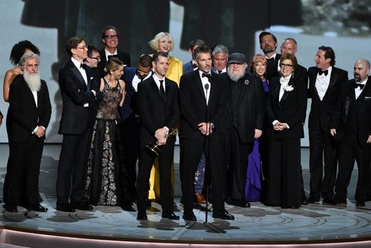 """""""Game of Thrones"""" co-creators D.B. Weiss (from left center), David Benioff and writer George R.R. Martin accept the outstanding drama Emmy along with the cast and crew."""