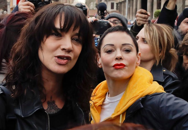 Actresses Asia Argento, left, and Rose McGowan participate in a demonstration to mark the international Women's Day in Rome, March 8, 2018.