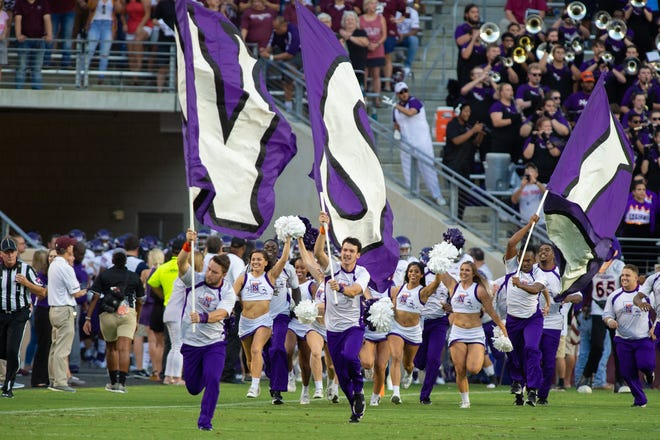 Northwestern State's cheer squad takes the field.