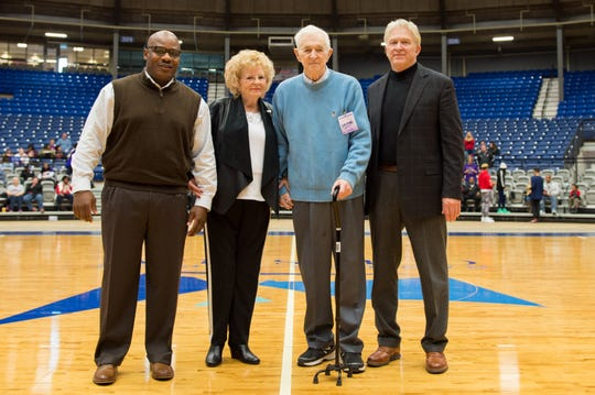 Longtime former Louisiana College coach Billy Allgood (second from right) is honored before a game between LC and Northwestern State last year. Pictured with him are (from left) LC basketball coach Reni Mason, Allgood's wife, Francis and NSU basketball coach Mike McConathy.