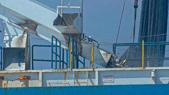 Menhaden are loaded onto an industrial-size fishing boat owned by Omega Protein, when the boat was six miles off the New Jersey on Sept. 6.
