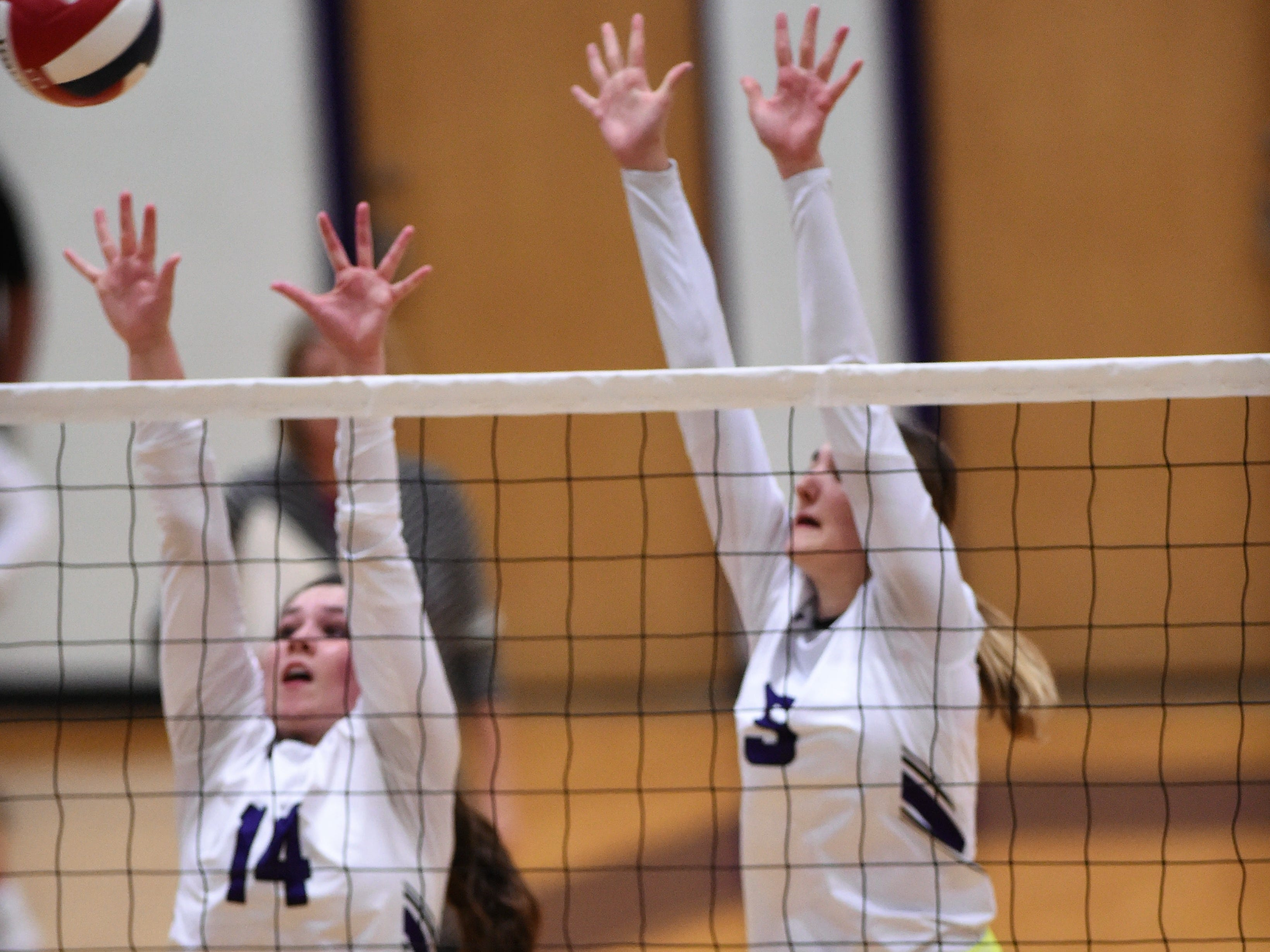 Wylie's Ginger Lanman (14) and Lily Kate Doby (5) reach for a block during the Lady Bulldogs' sweep of Big Spring on Tuesday, Sept. 18, 2018.