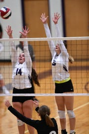 Wylie's Ginger Lanman (14) and Lily Kate Doby (5) reach for a block during the Lady Bulldogs' match against Big Spring.