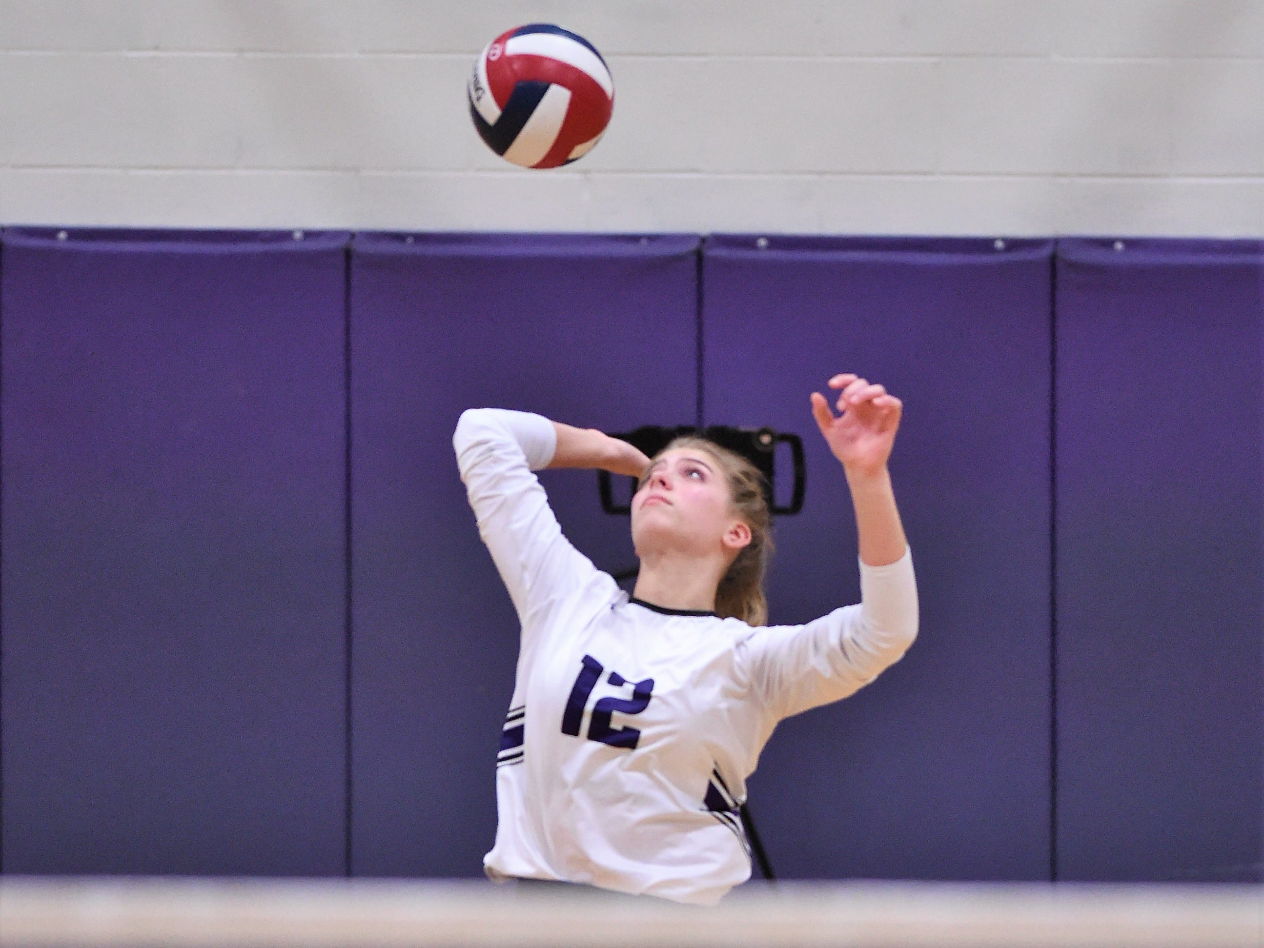 Wylie's Madison Burden (12) serves during the Lady Bulldogs' sweep of Big Spring on Tuesday, Sept. 18, 2018.