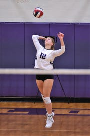 Wylie's Madison Burden (12) serves during the Lady Bulldogs' sweep of Big Spring.