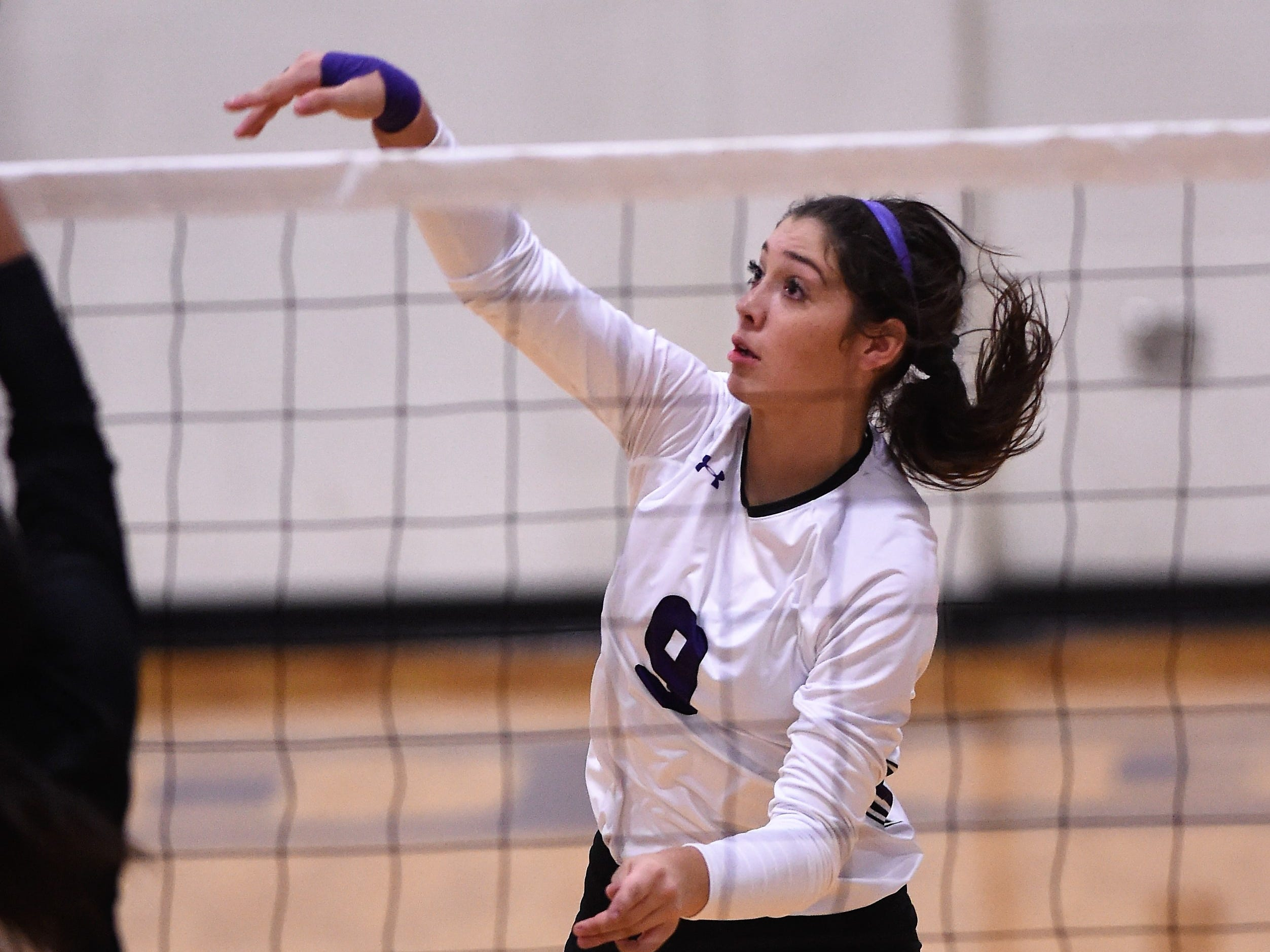 Wylie's Keetyn Davis (9) finishes off a kill during the Lady Bulldogs' sweep of Big Spring on Tuesday, Sept. 18, 2018.