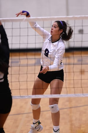 Wylie's Keetyn Davis (9) finishes off a kill during the Lady Bulldogs' sweep of Big Spring on Tuesday at Bulldog Gym.