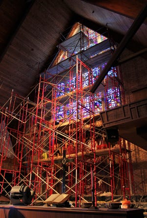 The altar at Aldersgate United Methodist Church was moved to the side to provide room for scaffolding to repair the area around a large stained glass window at the west end of the sanctuary. Work was completed this week.