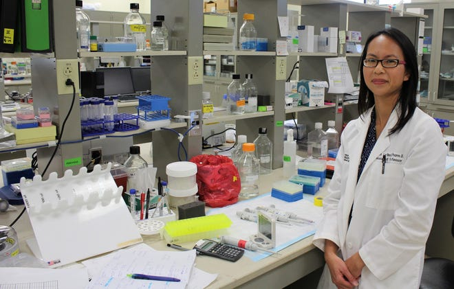 """Dr. Ninh """"Irene"""" La-Beck, most often found wearing a white coat and in a lab at the Texas Tech University Health Sciences Center, has been in Texas since 2010, recruited by Tech for cancer research."""
