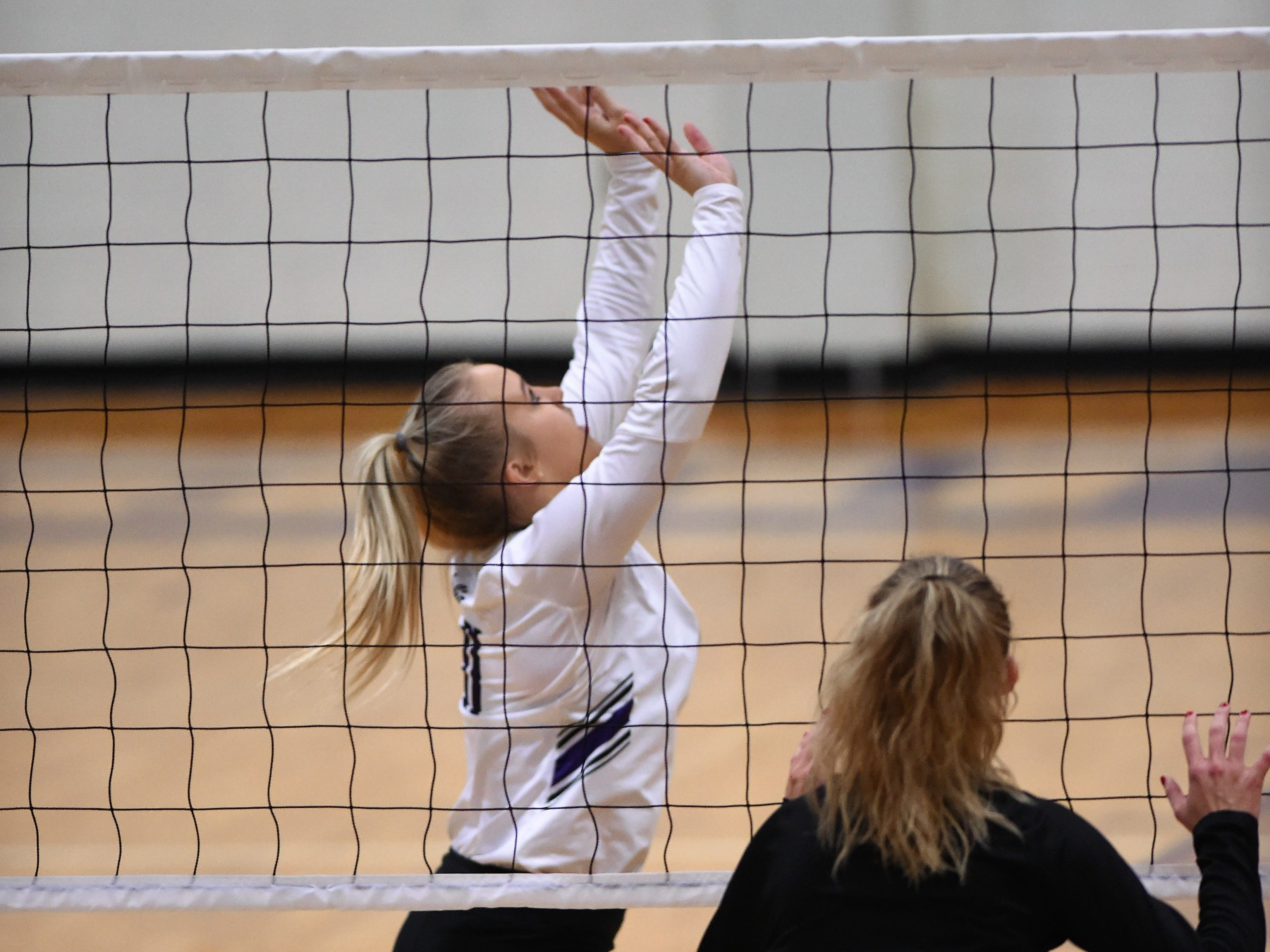 Wylie's Lexie Miller (11) sets during the Lady Bulldogs' sweep of Big Spring on Tuesday, Sept. 18, 2018.