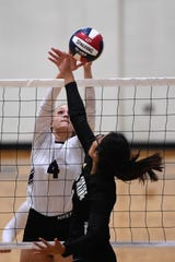 Wylie's Karis Christian (4) reaches for the ball at the net during the Lady Bulldogs' sweep of Big Spring on Tuesday.