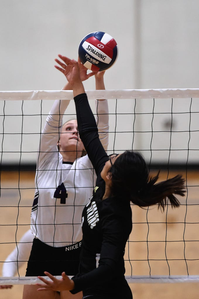 Wylie's Karis Christian (4) reaches for the ball at the net during the Lady Bulldogs' sweep of Big Spring on Tuesday, Sept. 18, 2018.