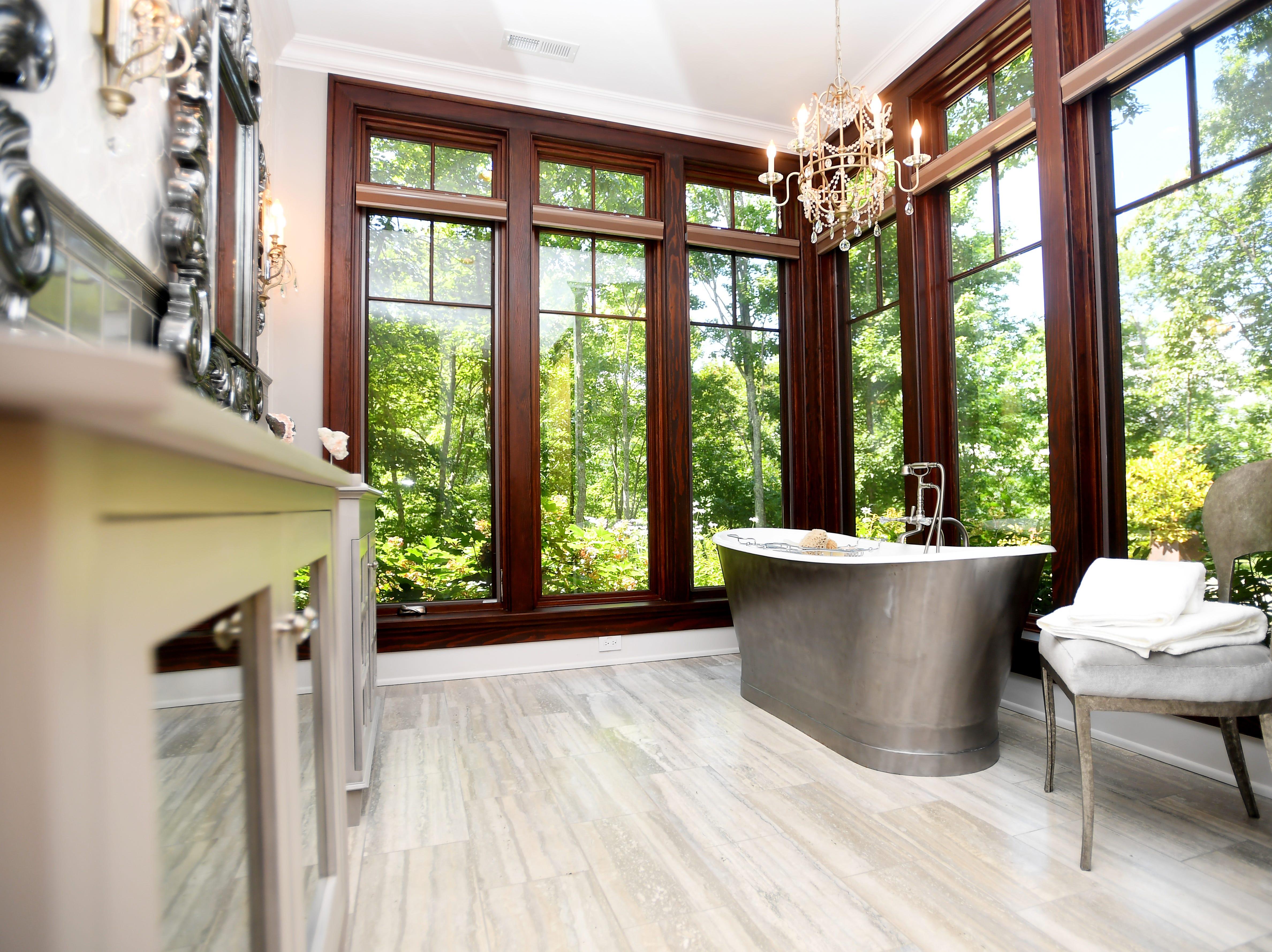 A bathroom on the basement floor of Bobbye and Ken Bowdon's Balsam Mountain Preserve home.