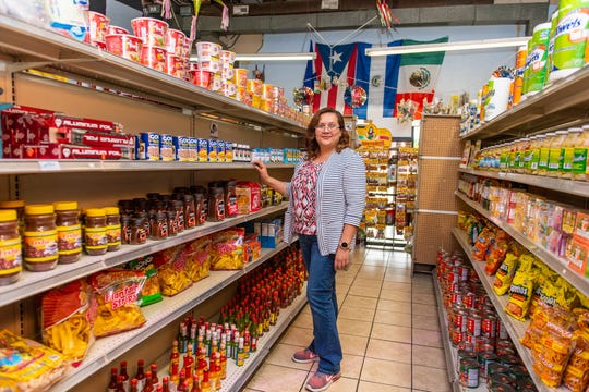 Conchi Molina makes sure her store is stocked with foods familiar to her Latino customers from their home countries.