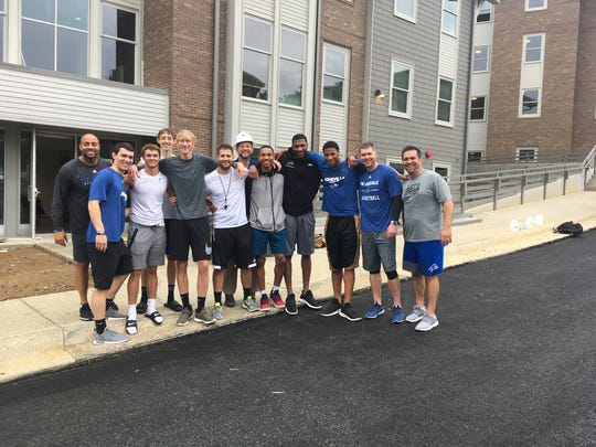Coach Mike Morrell and the UNC Asheville men's basketball team