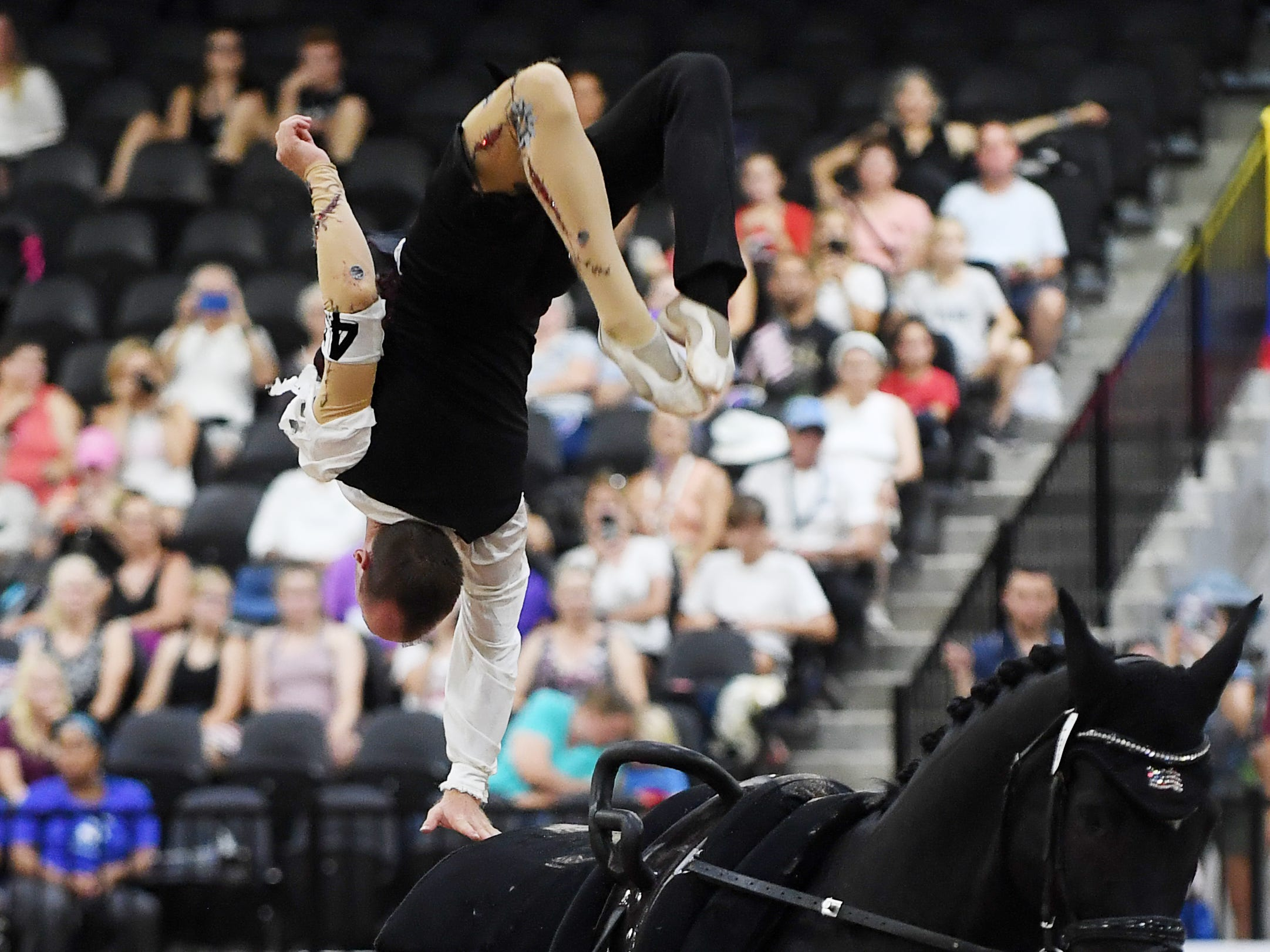 Kristian Roberts competes with horse Sir Charles in vaulting for the United States at the World Equestrian Games Sept. 19, 2018.