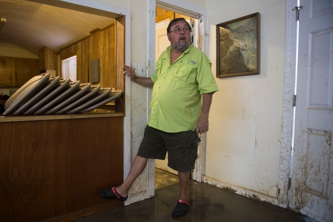 Ronnie Mayes looks around the fellowship hall of the church he's attended his entire life, the Presbyterian Church of the Covenant, in Spring Lake, N.C., on Sept. 19, 2018. The Little River flooded multiple of the church's buildings after Florence.