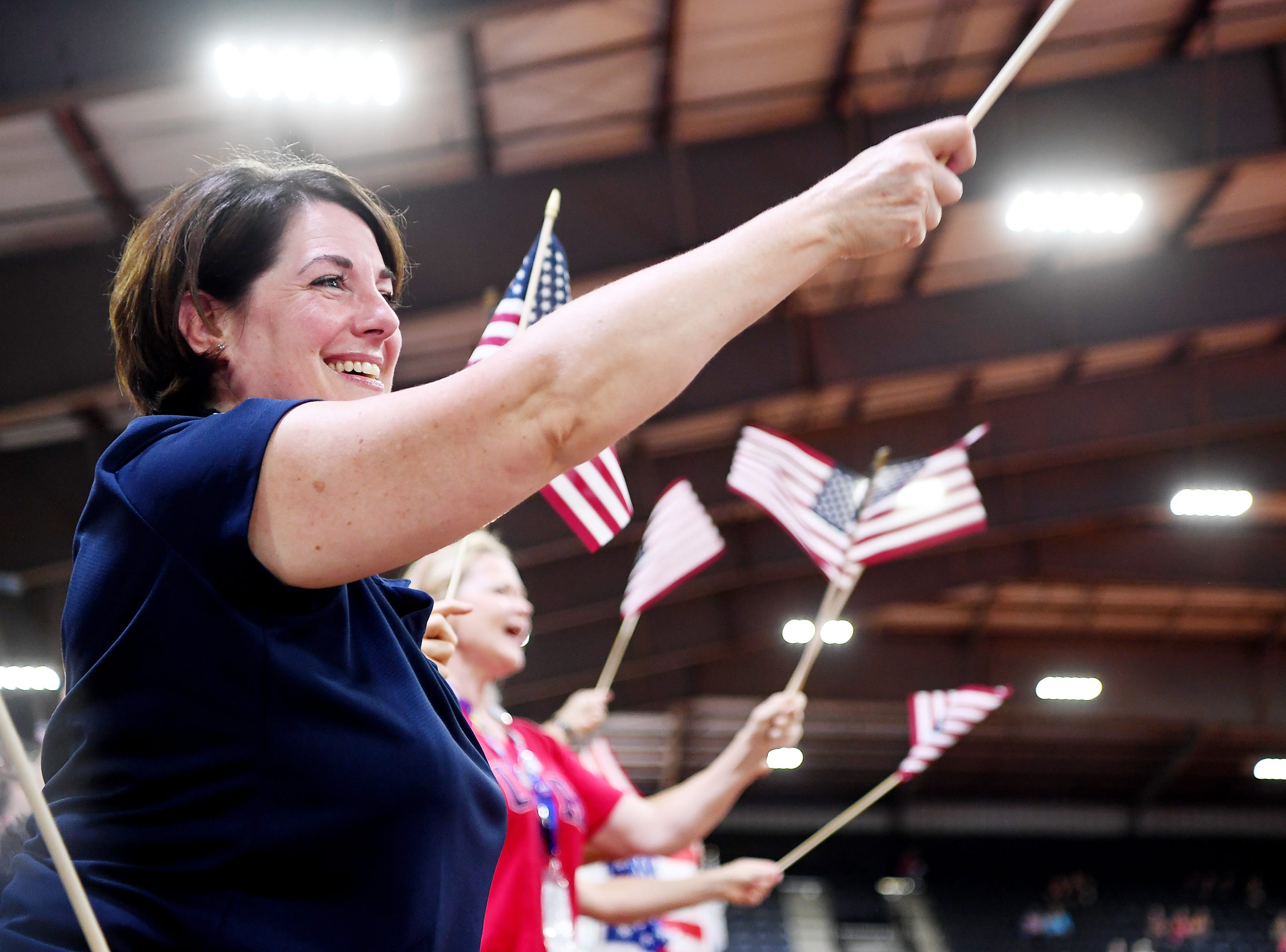 Valerie Janes cheers as her son, Daniel, enters the arena for the vaulting competition at the World Equestrian Games Sept. 19, 2018.