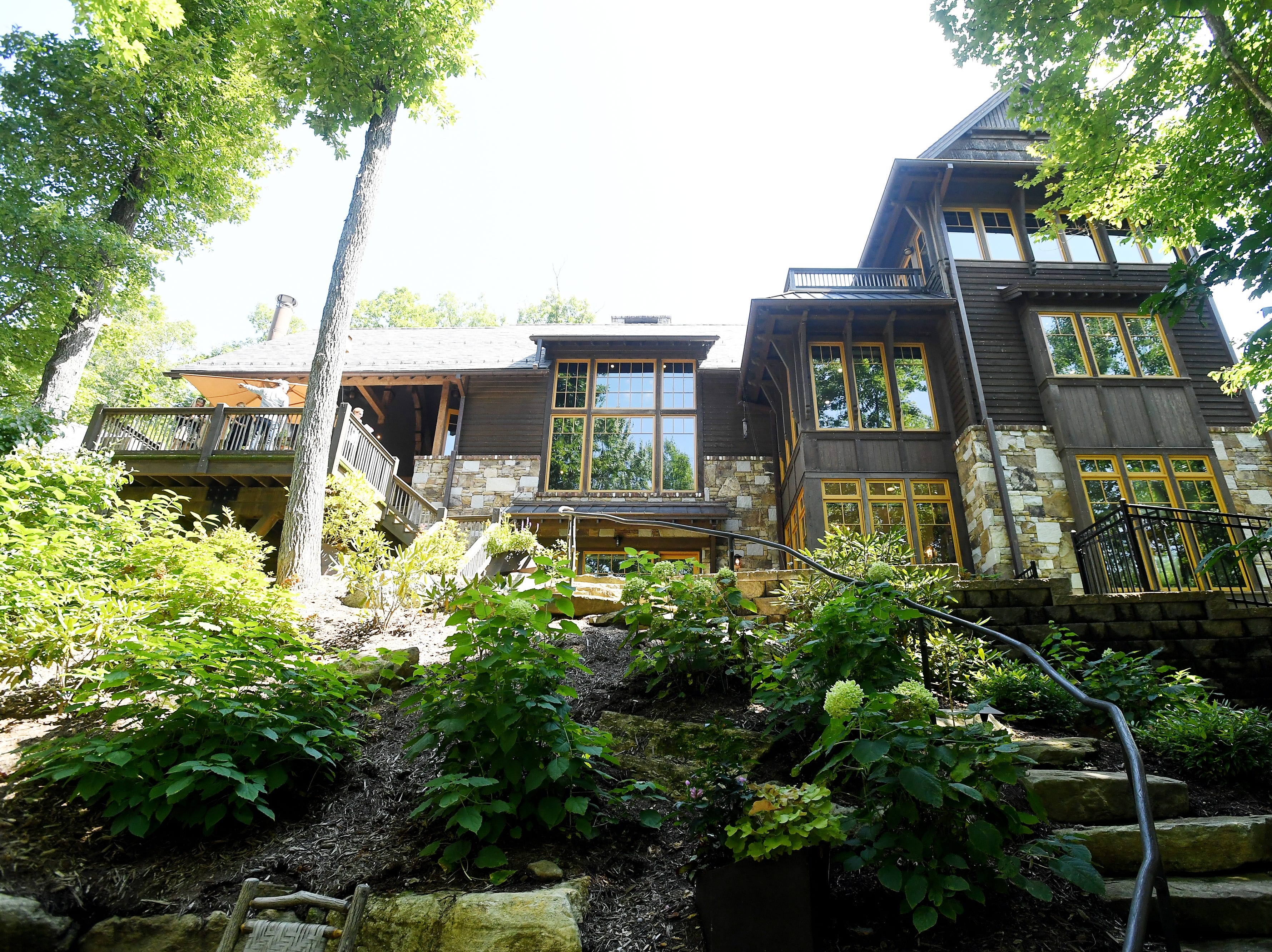 A view of Bobbye and Ken Bowdon's home from the fire pit in the backyard at Balsam Mountain Preserve home.