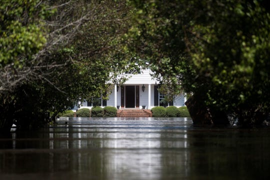 Lynn and Dianna Wood's house sits flooded in Linden, N.C., on Sept. 19, 2018. The Little River, which flooded due to Florence, runs behind their property.