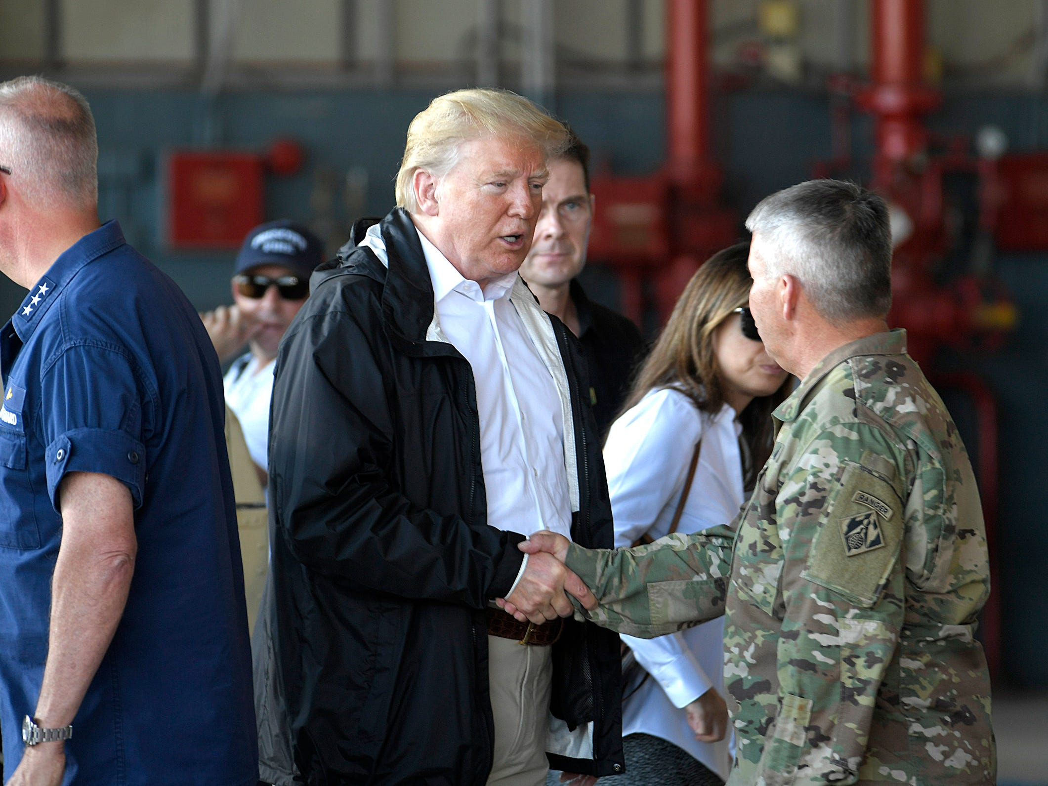 President Donald Trump shake hands with local and state officials during a briefing on Hurricane Florence on the tarmac at Marine Corps Air Station at Cherry Point in Havelock, NC on Wednesday, Sept. 19, 2018.