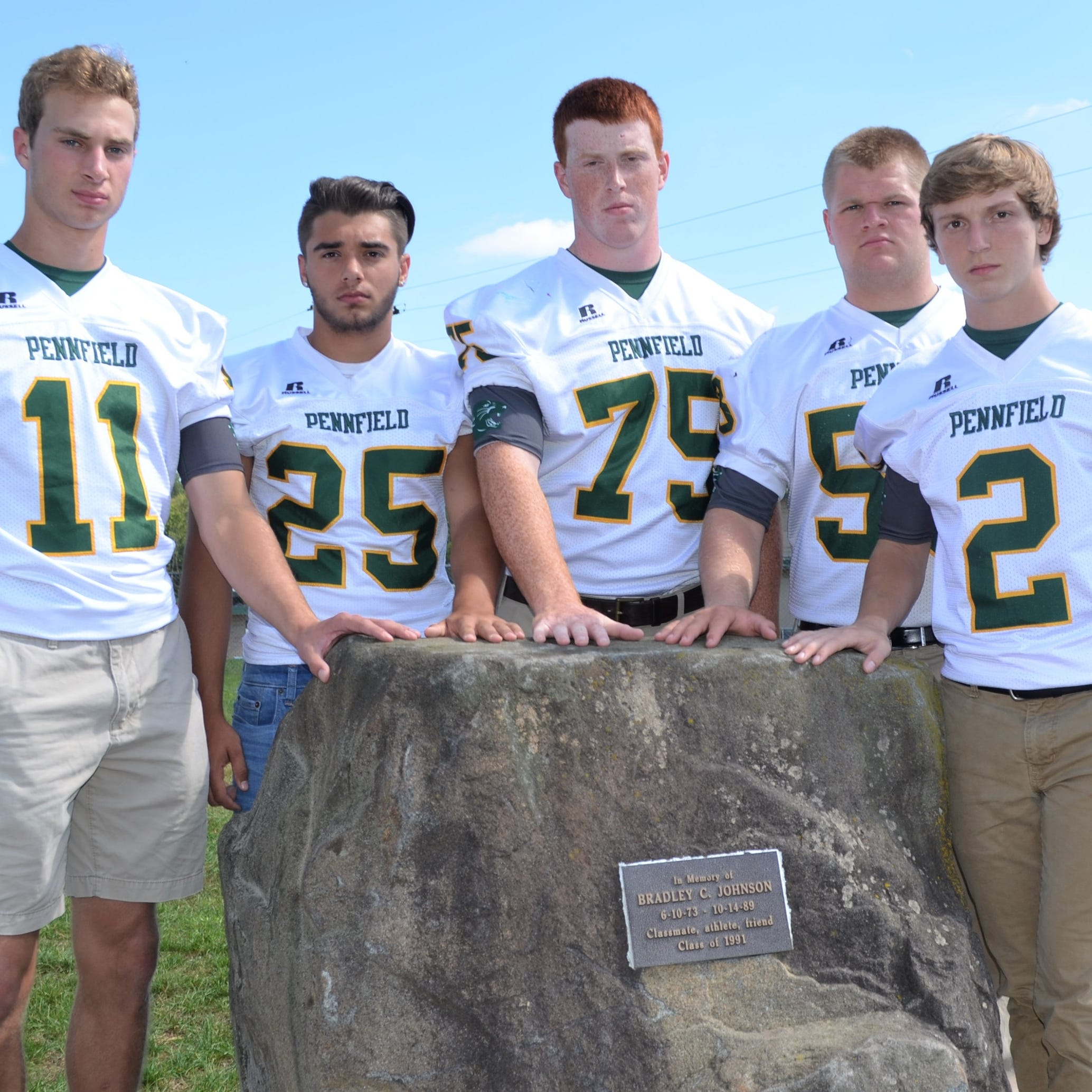 Here's why touching 'the rock' has become a new tradition for Pennfield football
