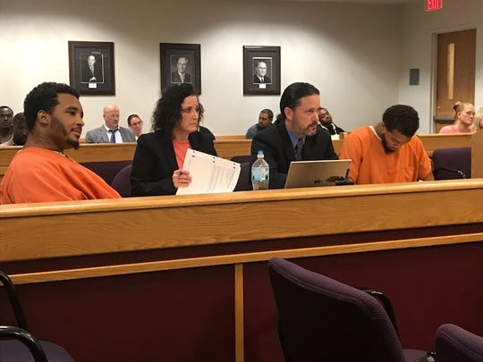 Devon West, left, with her attorney Melissa Heffner and Jarviz Brown, right with his attorney, Justin McCarthy, listen to testimony.