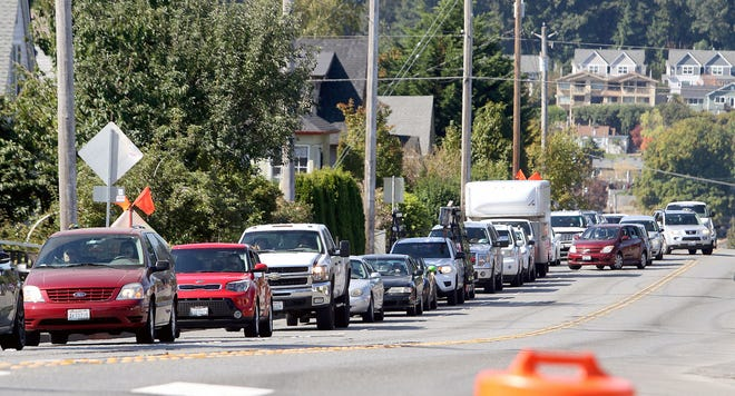 Contractors for the state department of transportation will begin night work Tuesday on Burwell Street between Callow Avenue and Warren Avenue. The work will include grinding and repaving the roadway. Pictured: traffic backs up on Burwell after a sinkhole opened on the road last year.