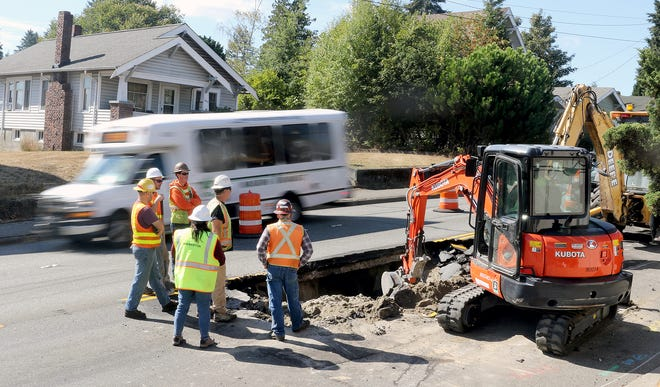 Emergency repairs are being made on a large sinkhole that developed Wednesday on Burwell Street between High and Anoka avenues.