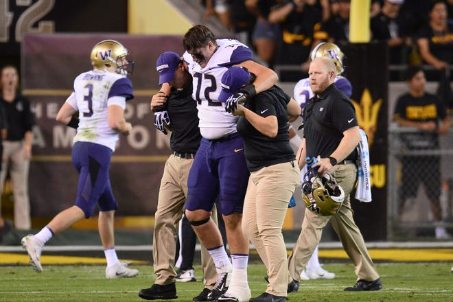 Huskies tackle Trey Adams was injured during an October 2017 game in Tempe against Arizona State. He hasn't played for Washington since.