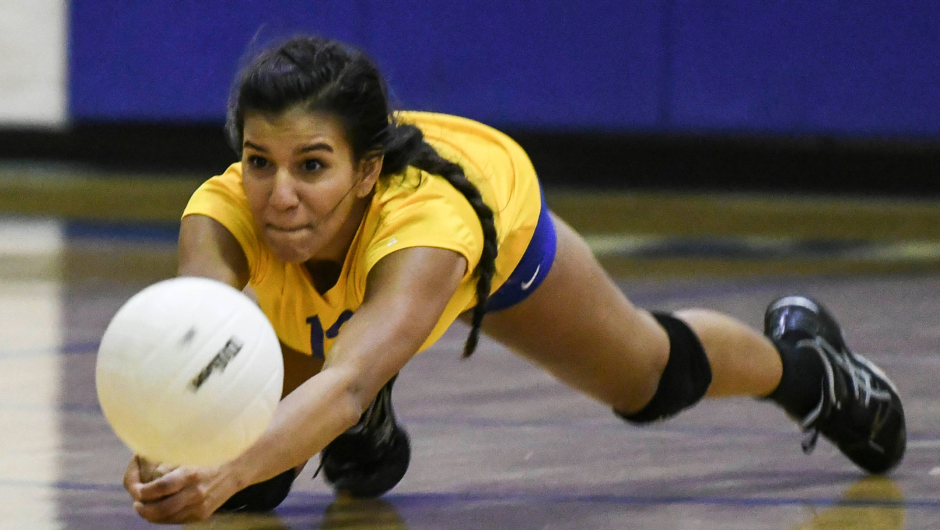 Christy Cavallero of Titusville dives for a ball...